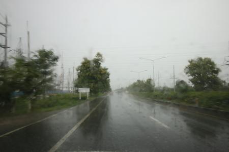 rain window: Heavy rush hour traffic in the rain