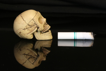 street drug: Three human skeletons with cigarettes.