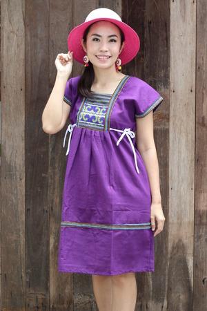 lobe: Thailand women wear traditional dress colors lobe of northern Thailand.