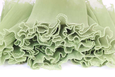 chiffon: Pressing on a green chiffon white background.