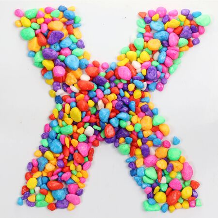literally: Colored stones arranged in a letter X.
