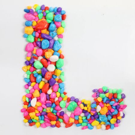 literally: Colored stones arranged in a letter L. Stock Photo