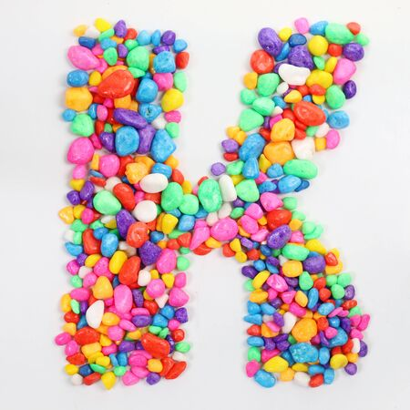literally: Colored stones arranged in a letter K.