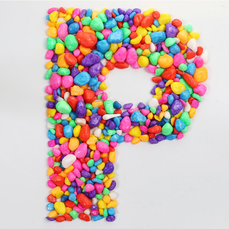 letter p: Colored stones arranged in a letter P. Stock Photo