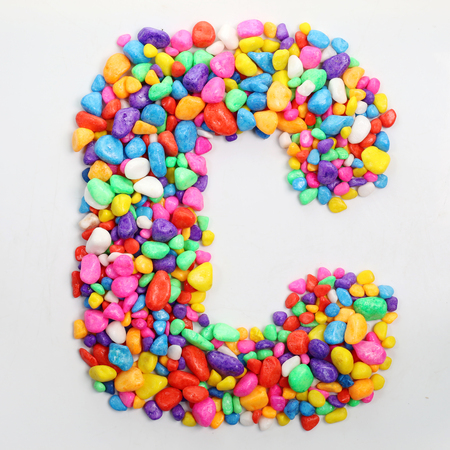 literally: Colored stones arranged in a letter C.