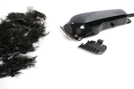 hairclipper: Hairclipper electricity with hairs on a white background.