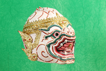 Khon mask on green background, thailand art head of human from Ramayana Story, art in thailand Stock Photo