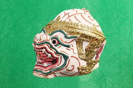 ramayana: Khon mask on green background, thailand art head of human from Ramayana Story, art in thailand Stock Photo
