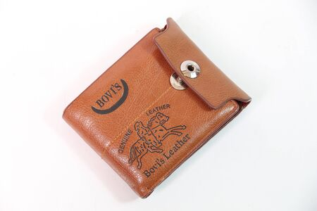 coin purses: Brown wallet on a white background.