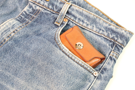 coin purses: Brown wallet in the pockets open hearing. Stock Photo