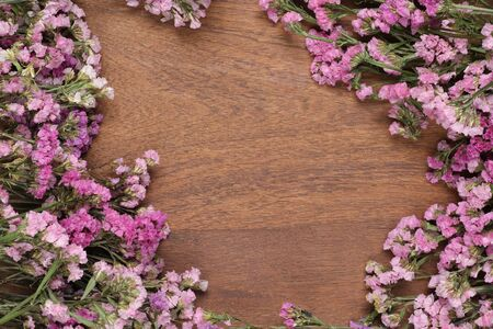 wooden surface: Flowers on the wooden floor