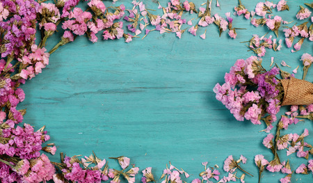 Beautiful flowers on green wood.