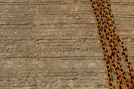 rusty chain: A rusty chain on a cement floor. Stock Photo
