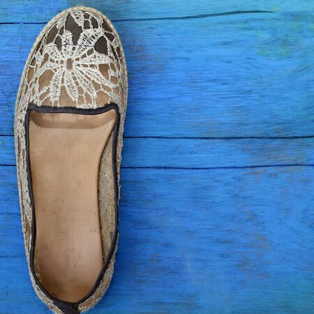 wooden floors: Womens shoes on wooden floors blue.