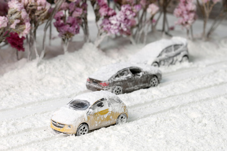driving conditions: Car on the road with heavy snow.