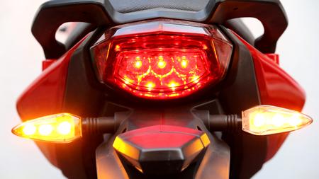 Motorcycle rear lights. Blurred shot. Фото со стока