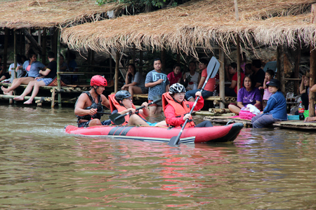 whitewater: Chiangmai, Thailand - March 27, 2016: Tourists paddle whitewater river in Mae Taeng district of Chiang Mai. Chiang Mai, Thailand.