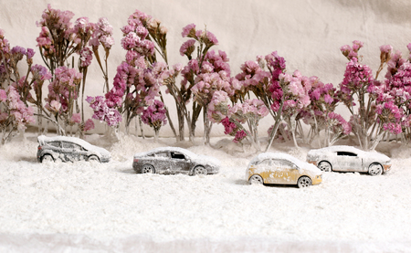 icy conditions: Car on the road with heavy snow.