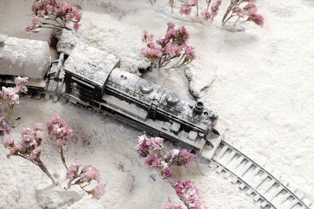 heavy snow: Trains steam head is covered with heavy snow. Stock Photo