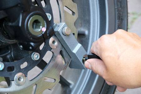 lock and key: Key lock disk brakes motorcycle. Stock Photo