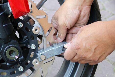 secure brake: Key lock disk brakes motorcycle. Stock Photo