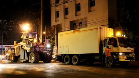 construction vibroroller: Chiangmai, Thailand - April 25, 2016: Road construction at night. Chiang Mai,Thailand.