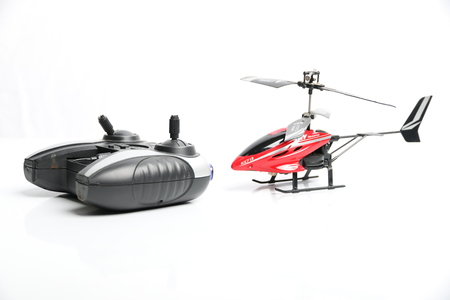 airscrew: Remote controlled helicopter with controlling handset, isolated on white background