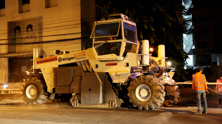 construction vibroroller: Chiangmai, Thailand - April 25, 2016: Road construction at night. Chiang Mai,Thailand.