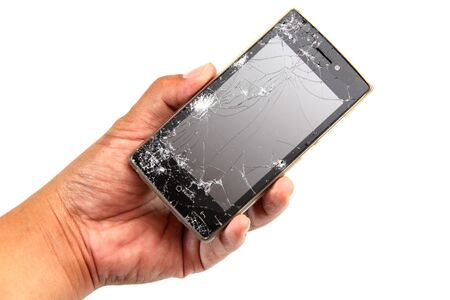 crashed: Cracked screen Smartphone in mens hands  isolated on white background.