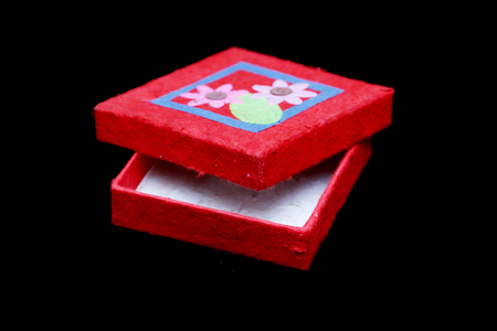 mulberry paper: Mulberry paper boxes in red on a black background. Stock Photo