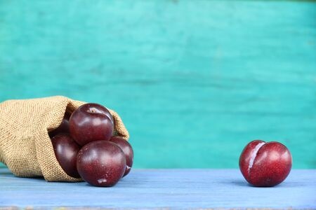 Ripe nectarines on old wooden blue.