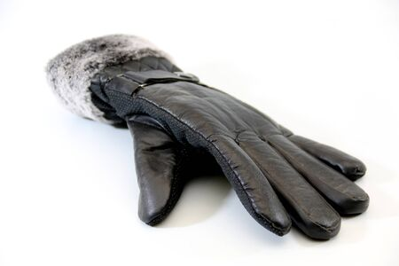Closeup of black leather gloves on white background