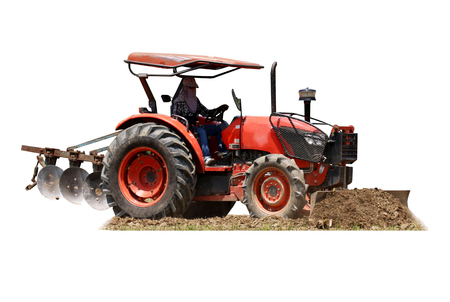 Tractor ploughing a field  isolated on white, with clipping path. 스톡 콘텐츠