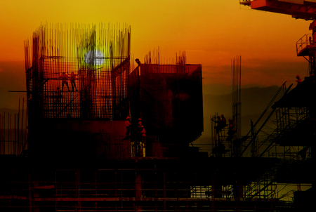 Double exposure building Construction, sunset blur 스톡 콘텐츠