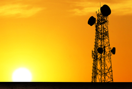Shadow silhouette,telecommunication towers towers with sunset background blur
