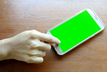 Women are using smartphones green screen.