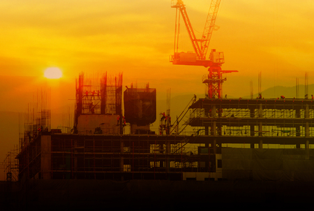 Double exposure building Construction with Crane, sunset blur