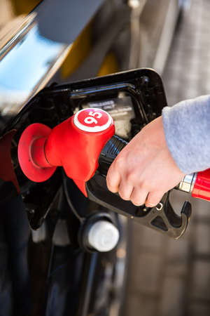 refilling: Refilling the car. Shallow depth of field. Stock Photo