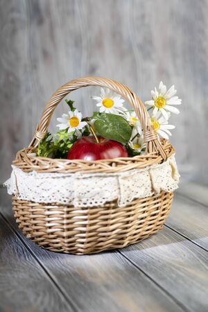 Red juicy ripe apple lie in basket. 写真素材 - 128903116