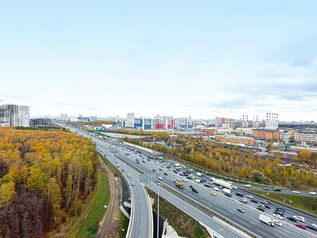 Drone flies over the road urban junction. Highway in Moscow. Bird's eye view.