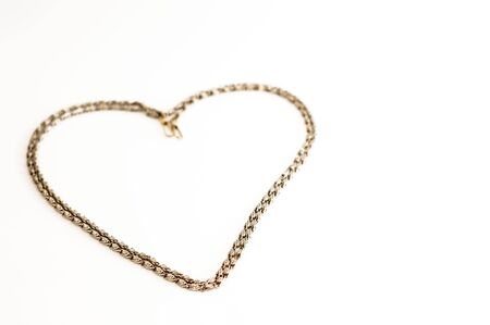 Thick golden chain - heart frame. Jewelry decoration. Stock Photo