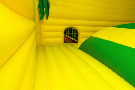 large inflatable yellow trampoline located in children's entertainment center