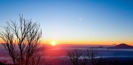 the sun rises on the mountain tops sindoro, wonosobo, west java, indonesia