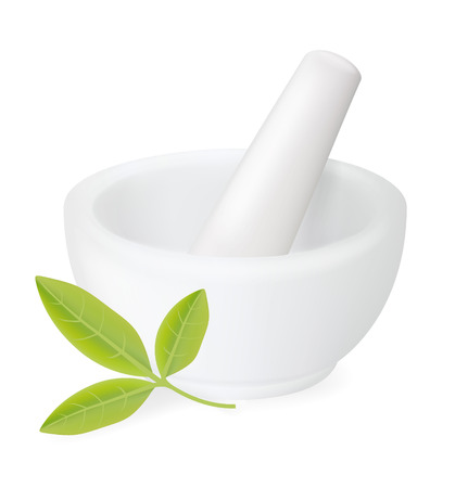 Healing herbs in white ceramic mortar