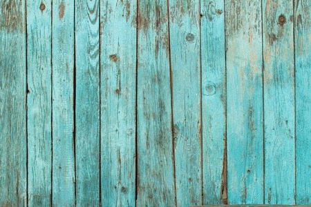 Battered old wooden blue wall. Background texture photo