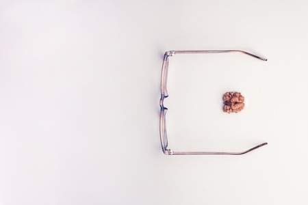 Glasses with a brain. On a white background Banque d'images