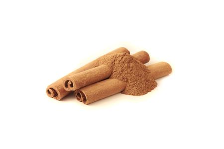 Cinnamon sticks and powder on white background