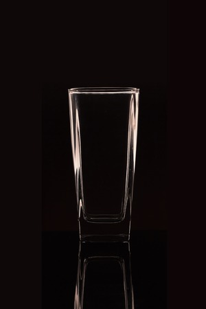 Glass on the water on a black background