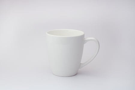 White cup isolated on the white background.