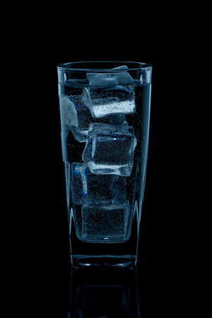 A glass with water on a black background Banque d'images